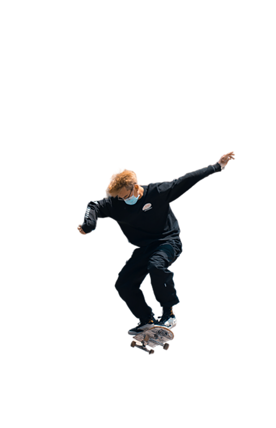 Skateboarder is trying a kickflip transparent background PNG