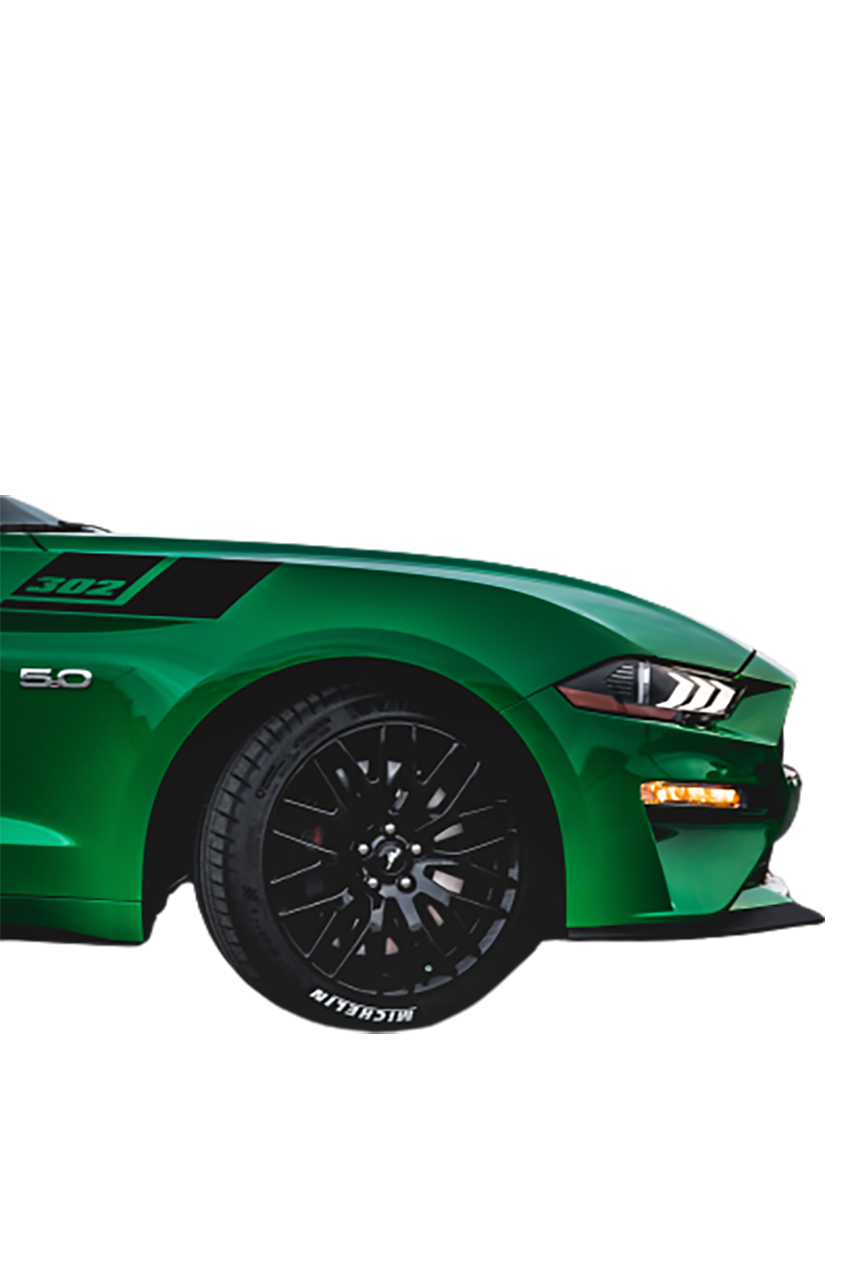 Green racing car, side view transparent background PNG