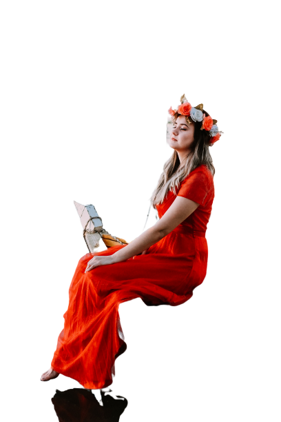 Girl sitting in red/orange dress on long chair Transparent Background PNG