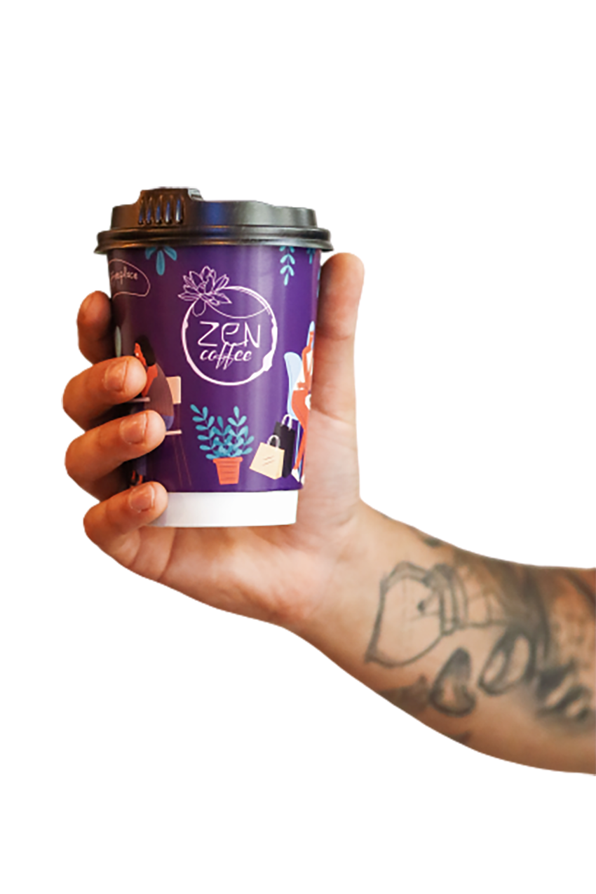 Violet colored sustainable coffee cup in hand transparent background PNG