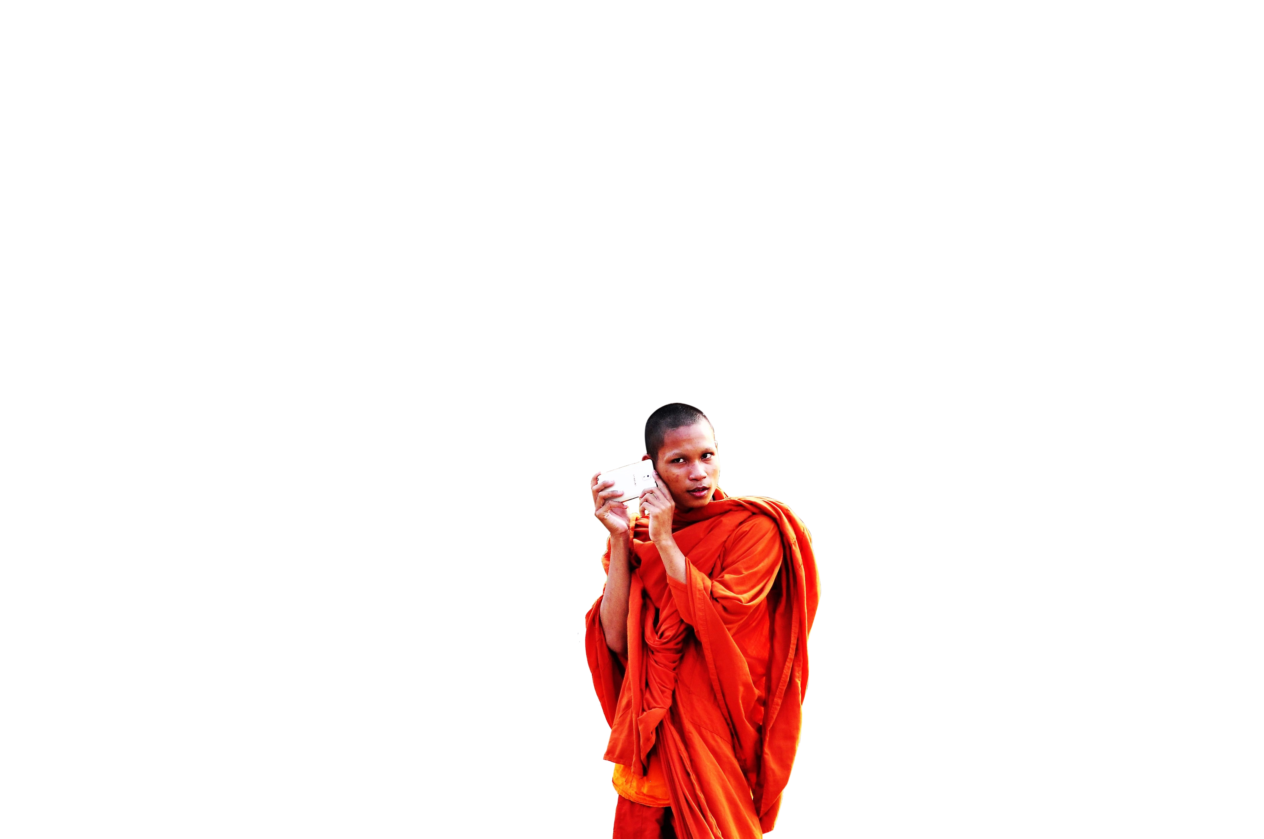 Buddhist in red color with phone in hand transparent background PNG