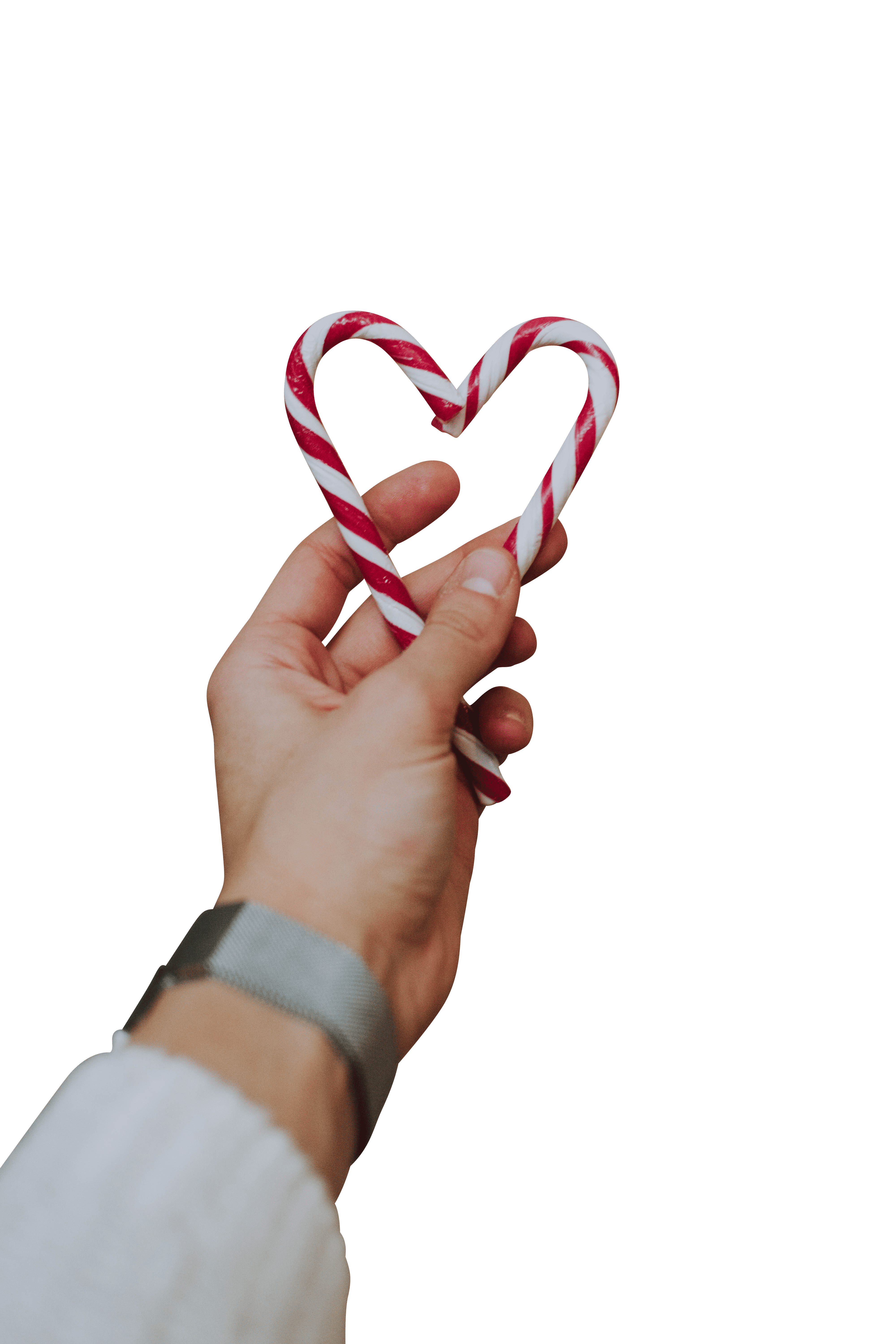 A man making heart shape with Christmas candy canes transparent background.png